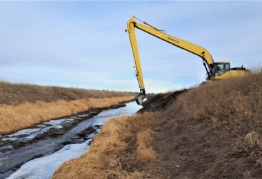 North Dry Creek Drainage District dredging excavator